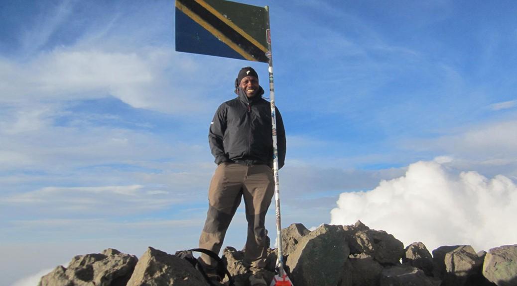 Godson Kastai at the peak of Mt Meru